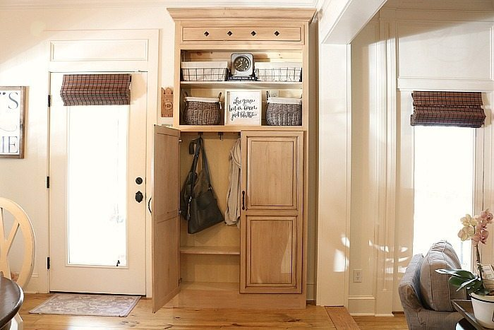 Cabinet repurposed into a mudroom closet