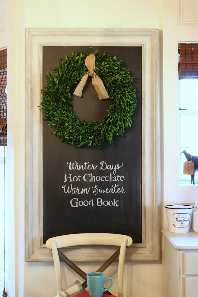 Chalkboard with winter quote plus that boxwood wreath