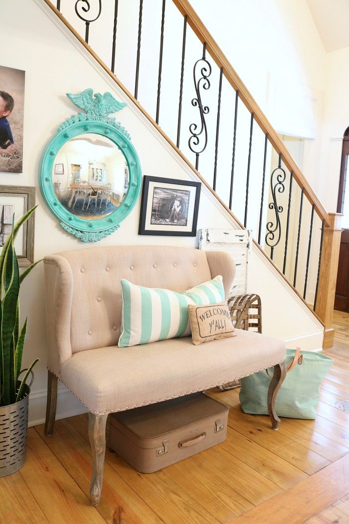 Loving the aqua and turquoise convex mirror in the entry