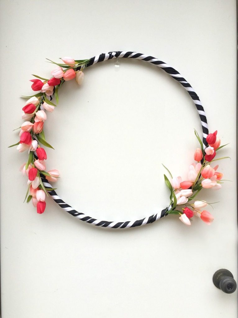 Hula Hoop spring wreath with black and white ribbon