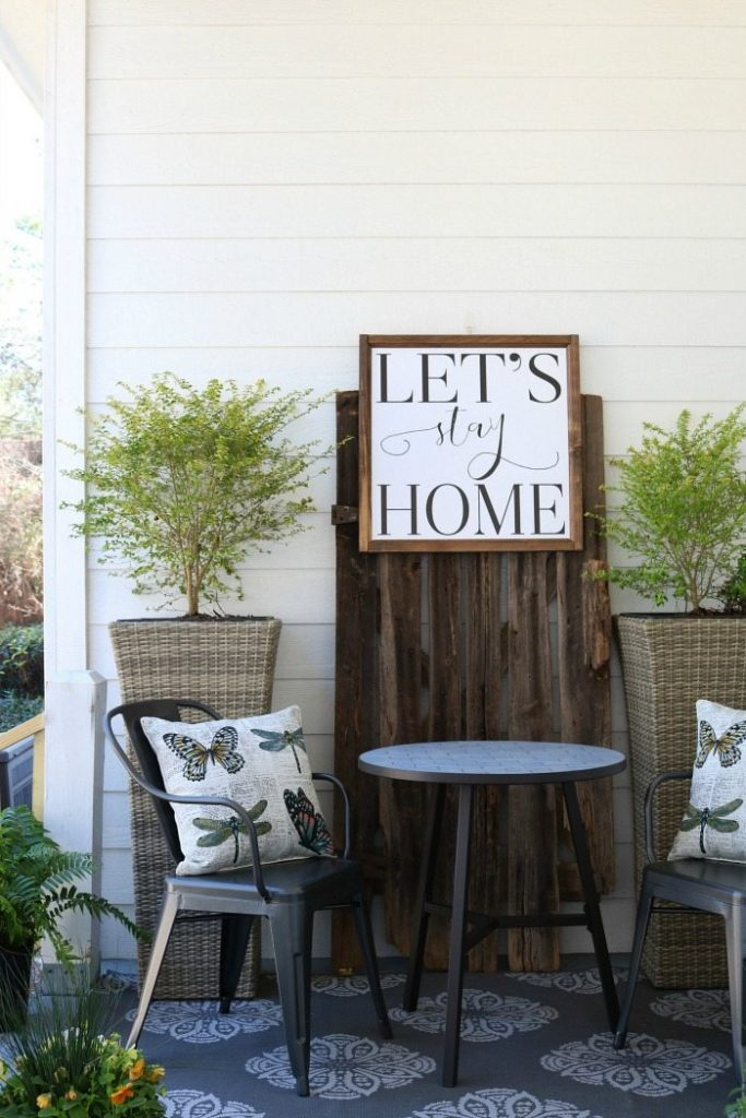 Shiplap barn wood metal chairs make a great conversation area on the porch at the Alabama Farmhouse
