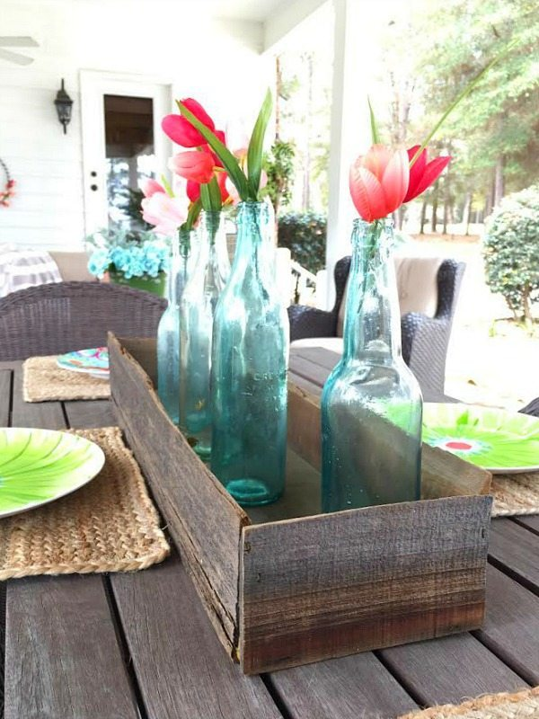 Barn wood box with old bottles for a farmhouse centerpiece
