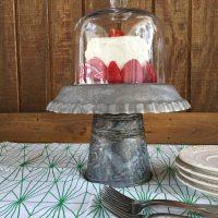 Cloche covered galvanized cake stand