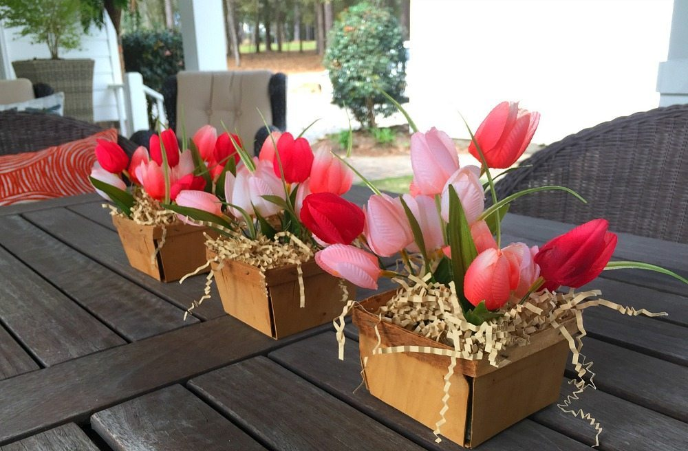 Farmhouse centerpiece created with berry baskets and tulips