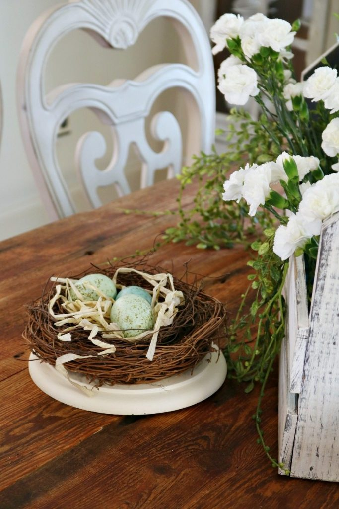 Nests with speckled eggs are great for spring tablescapes at Refresh Restyle