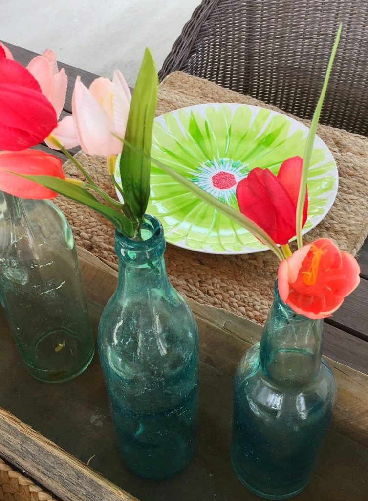 Spring colors with aqua glass bottles and tulips