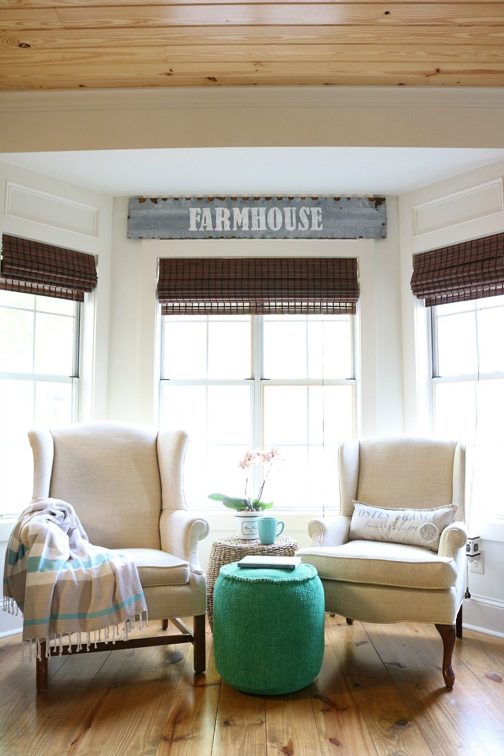 Cozy corner in the kitchen perfect for this metal farmhouse sign