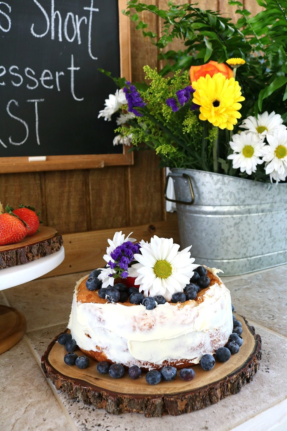 Farmhouse desserts served on wood slices with flowers in galvanized tub