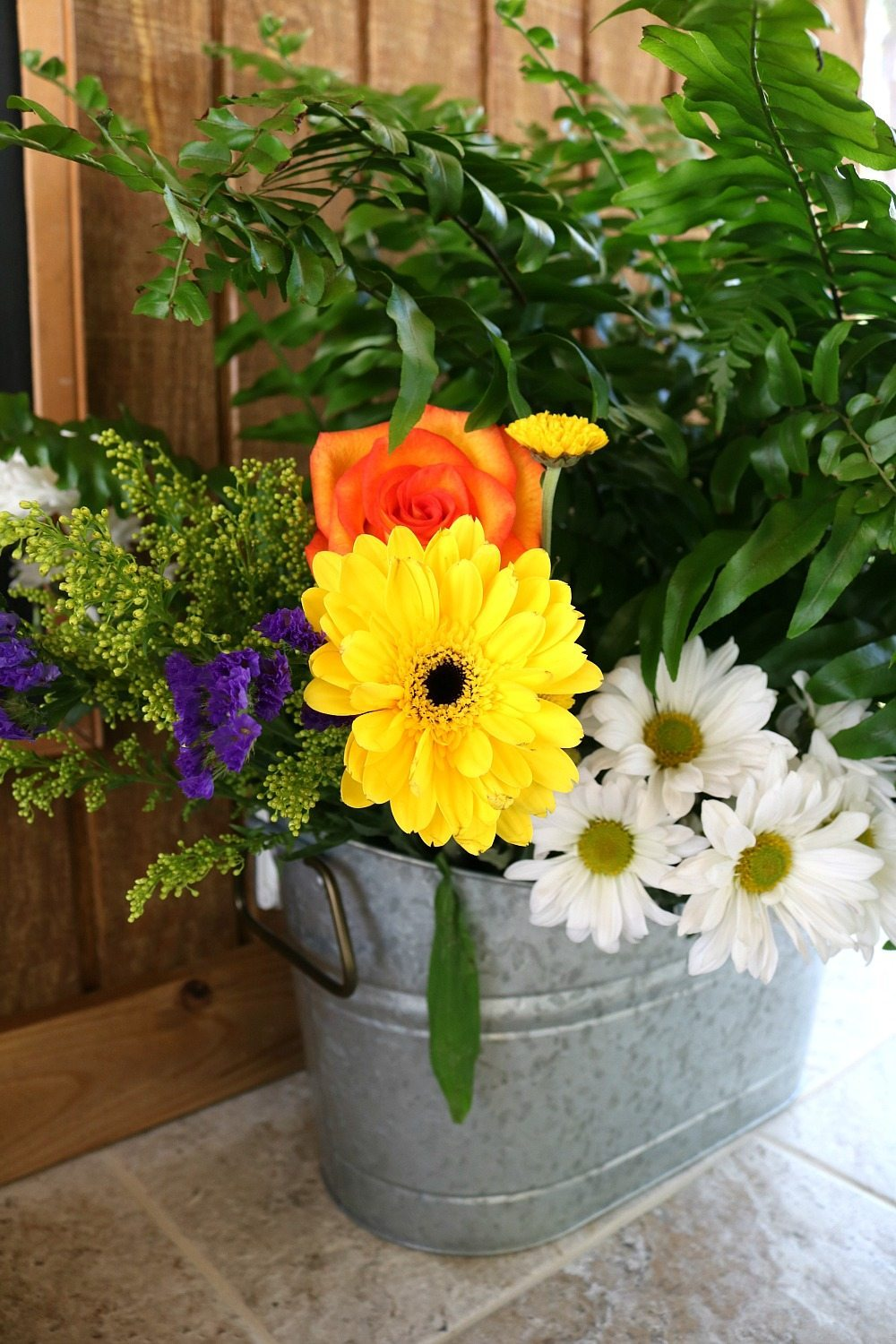 Farmhouse flowers in a galvanized bucket perfect for any decor