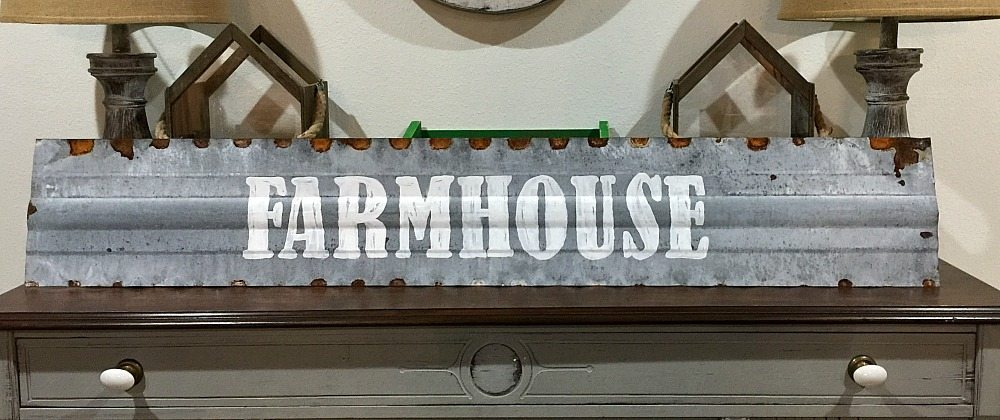 Farmhouse metal sign hand painted on the top of chicken feeder