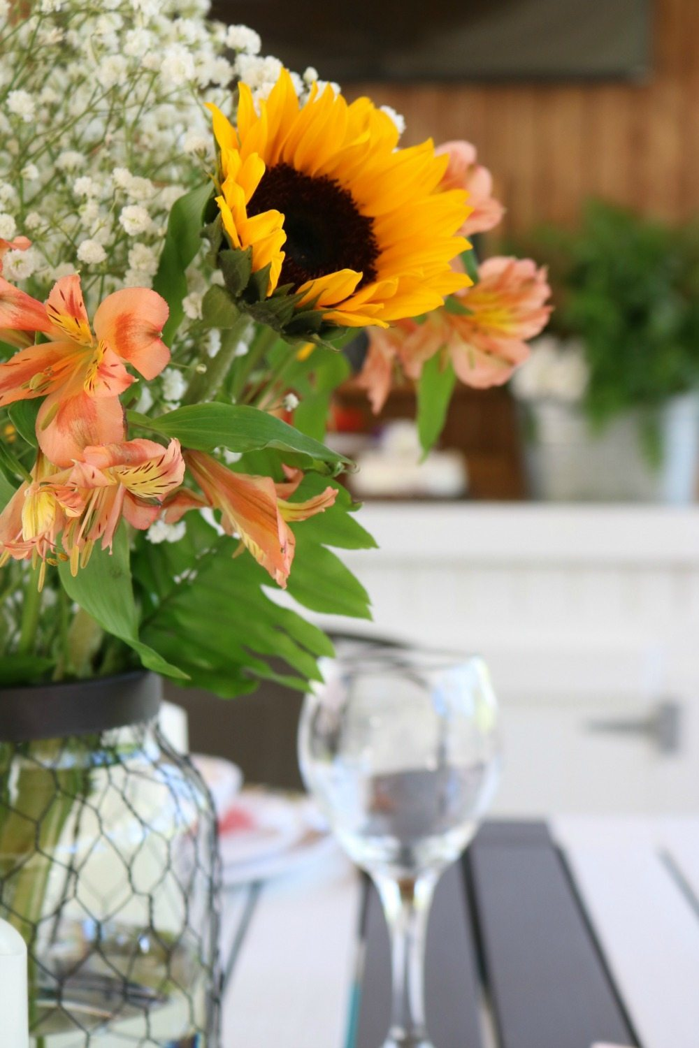 Grocery store flowers in Better Homes and Gardens chicken wire candle holder