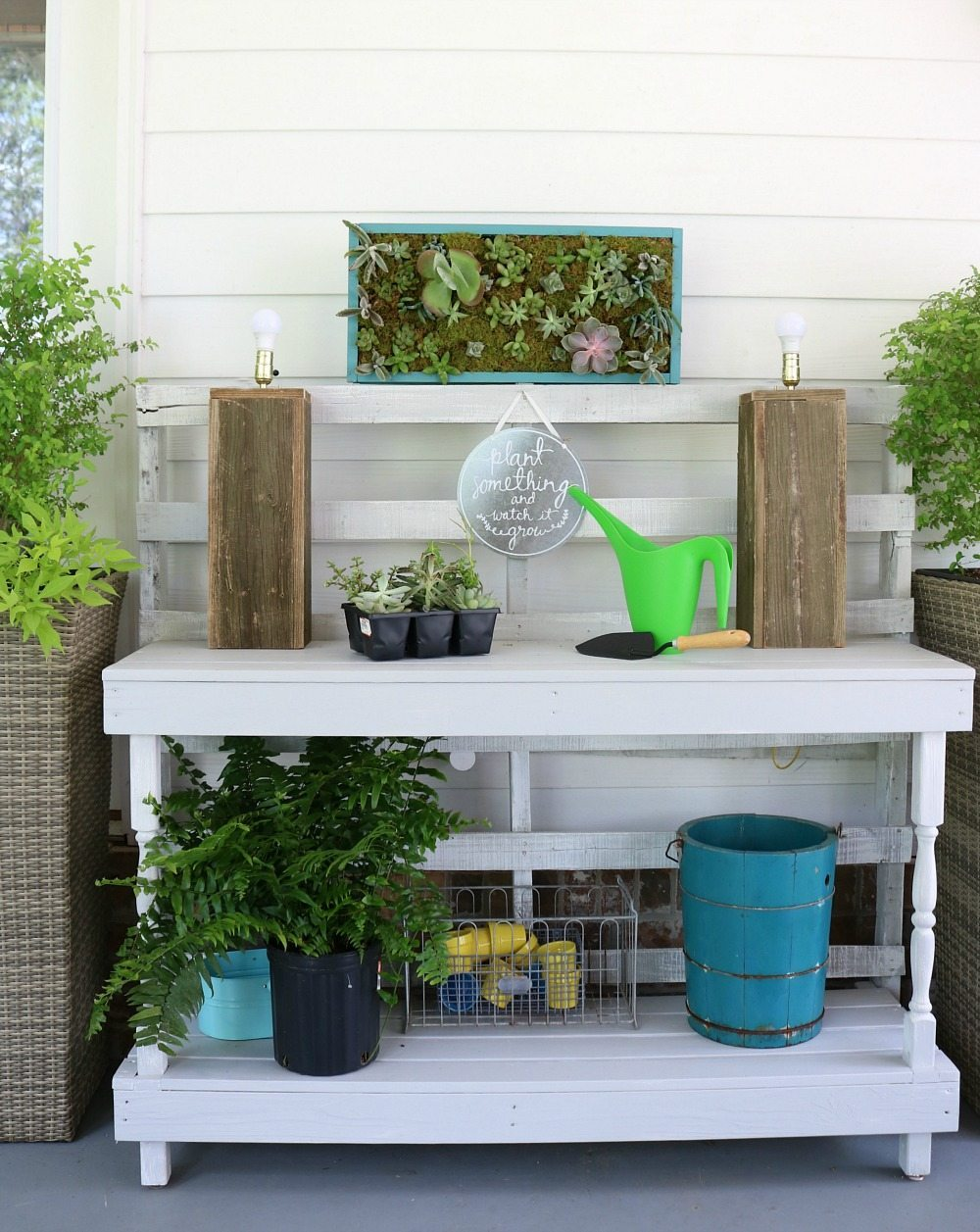 Potting table made from pallets with a vertical succulent garden perfect for the back porch