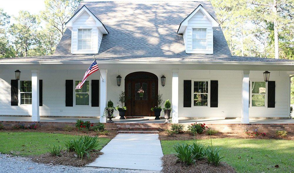 Curb appeal for the Alabama farmhouse add colorful plants