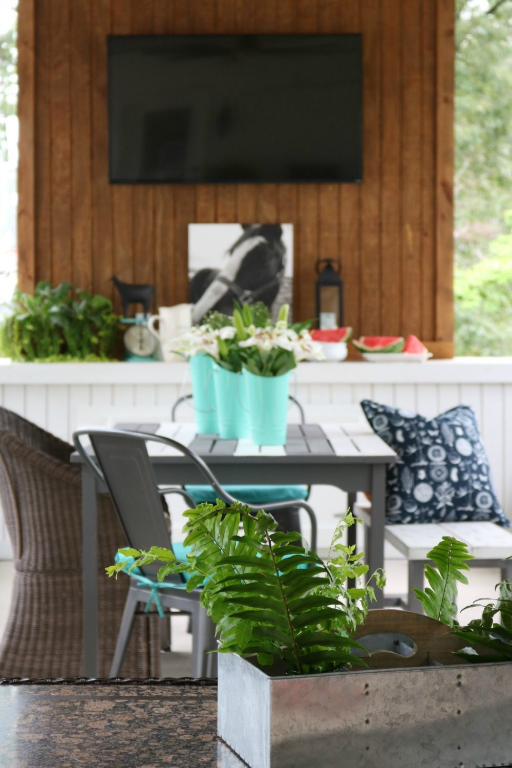 Ferns in galvanized metal on the farmhouse porch at Refresh Restyle