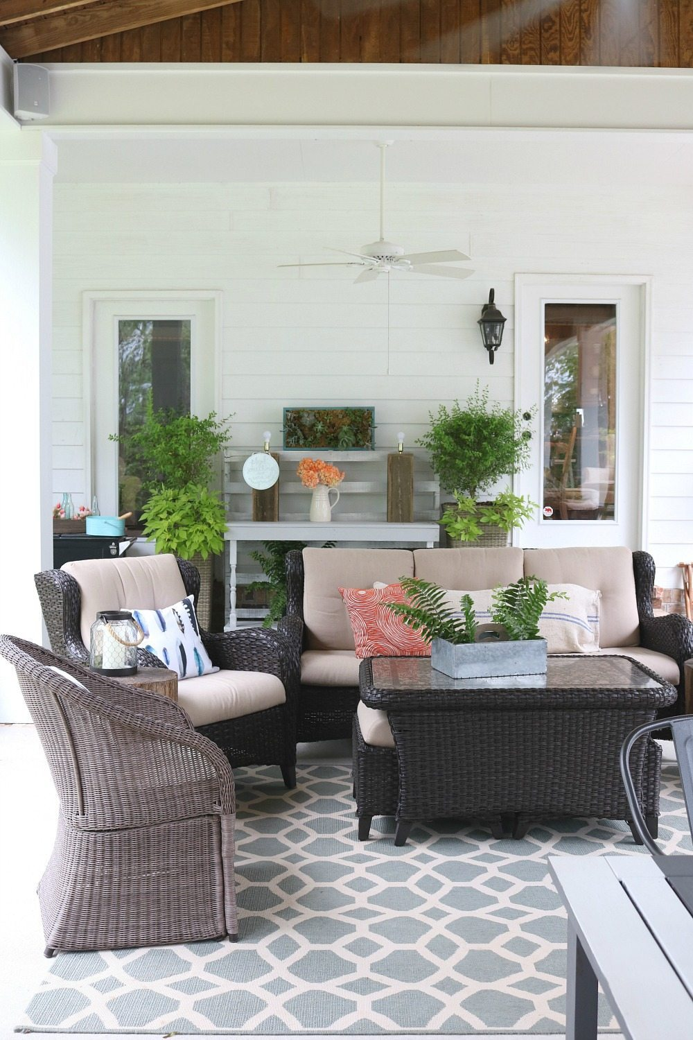 Living area on the summer ready porch at Refresh Restyle