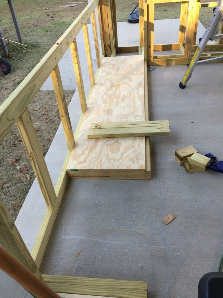 Putting the flooring in before we built the walls for outdoor kitchen