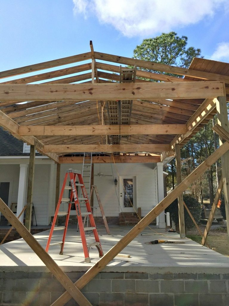 Rafters going up for the roof at Refresh Restyle patio into porch refresh