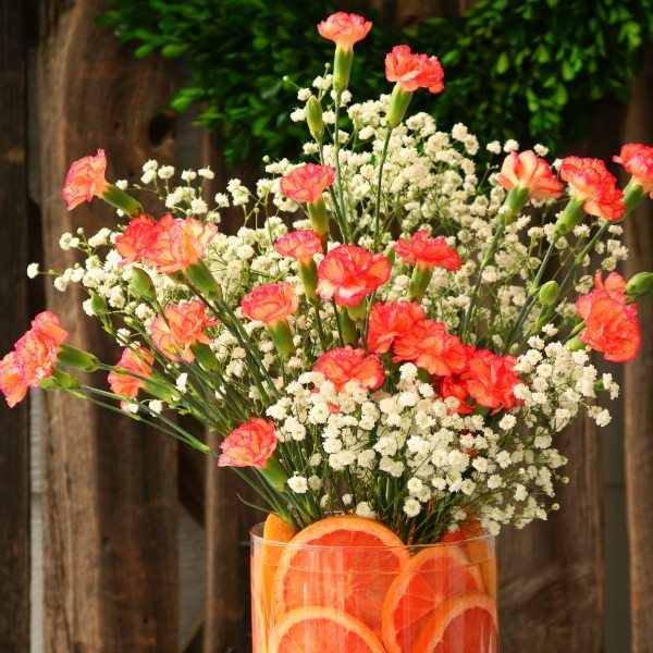 Red grapefruit floral arrangement