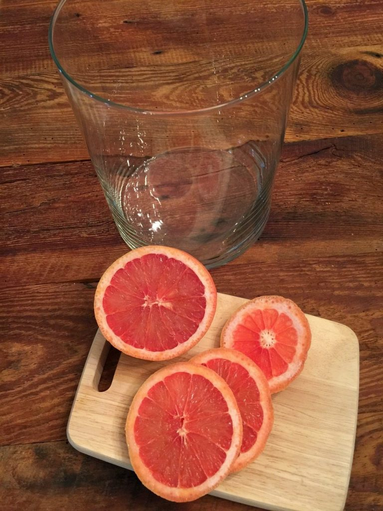 Red grapefruit sliced for a floral arrangement