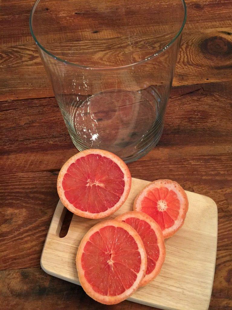 Red grapefruit sliced for a floral arrangement