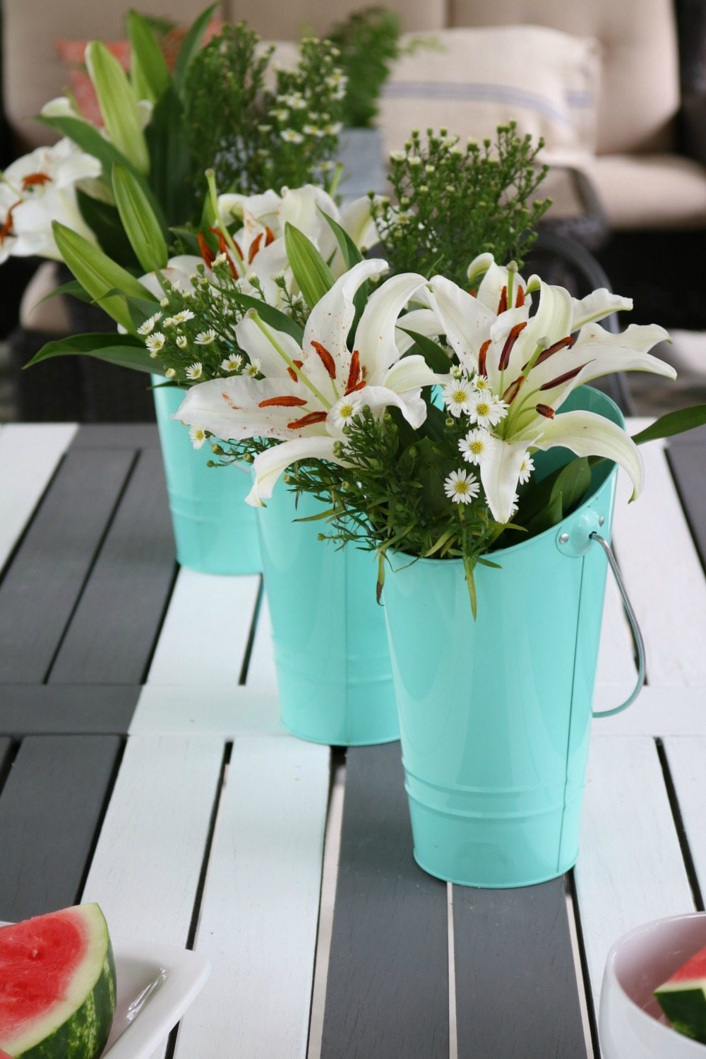Target Dollar spot buckets are perfect for vases on the porch at Refresh Restyle