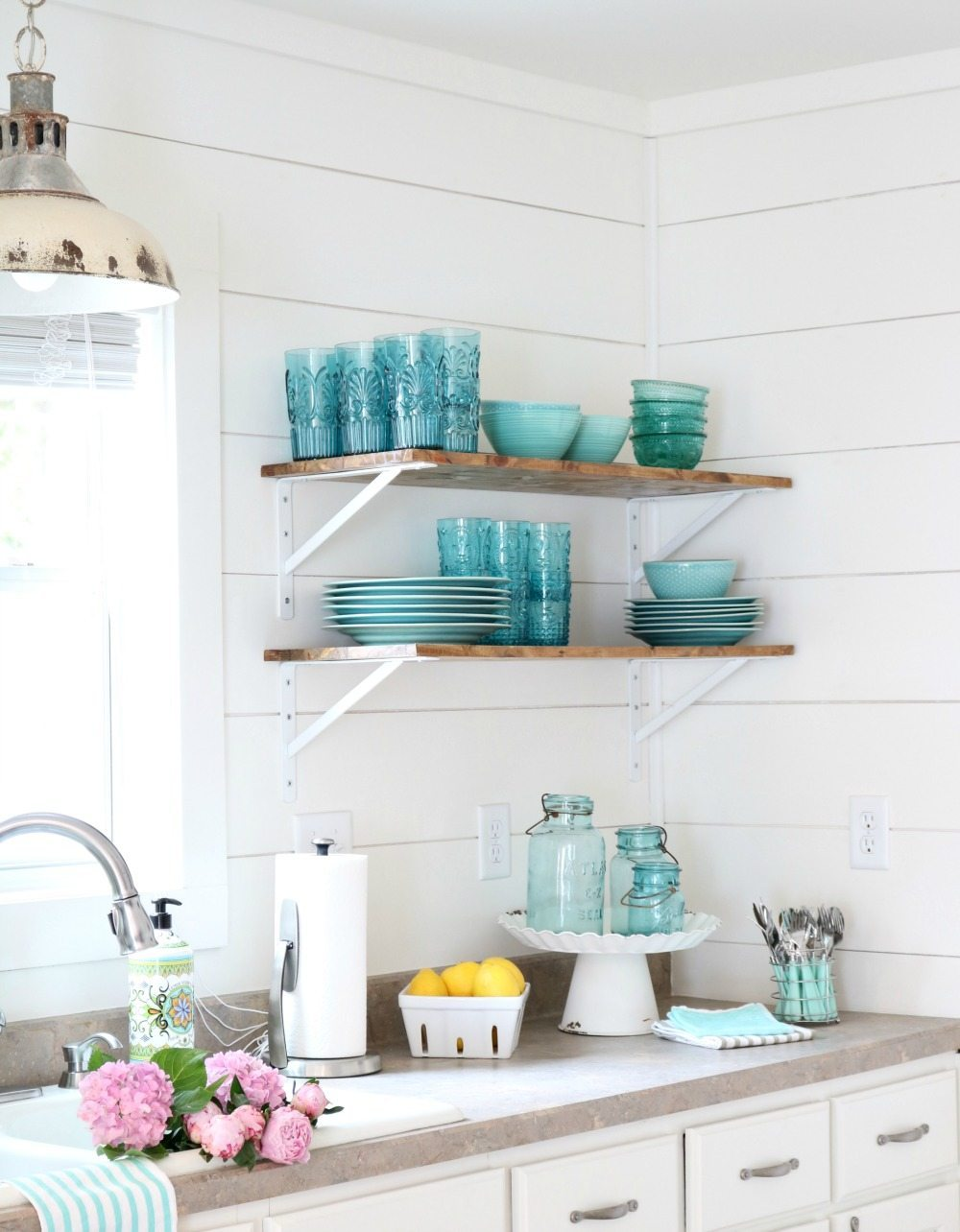 Alabaster walls with shiplap and open shelves are perfect for aqua turquoise dishes at Refresh Restyle