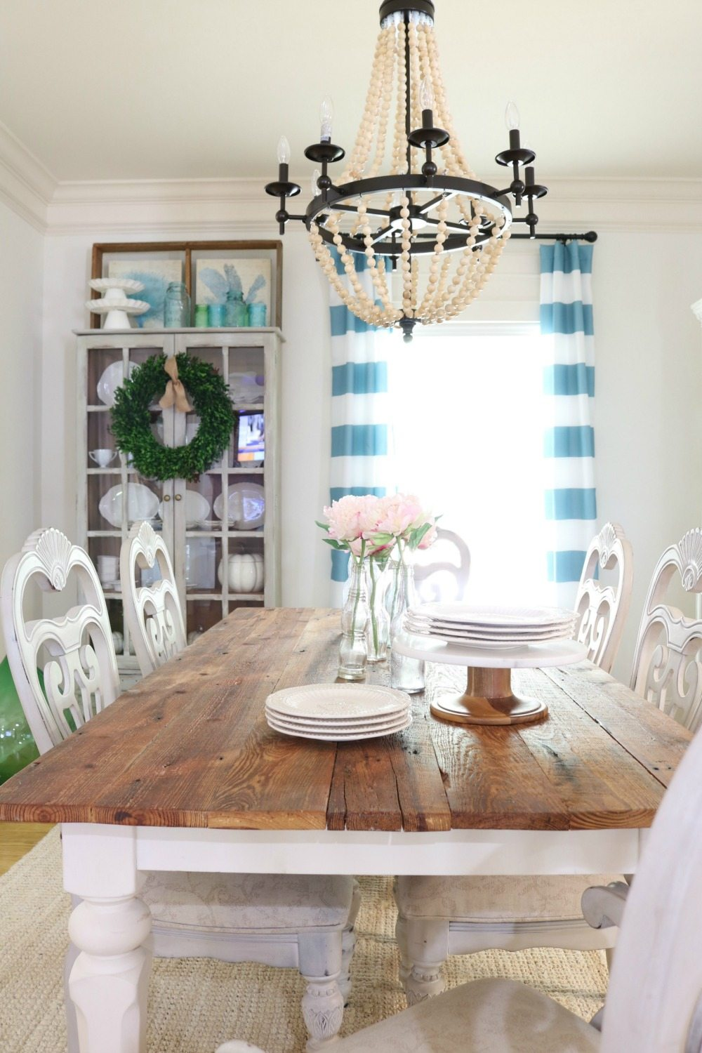 Barnwood table and striped curtains in the dining room