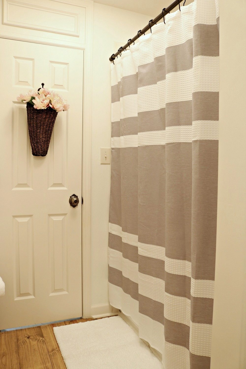 Gray and white waffle striped shower curtain perfect for a neutral farmhouse look