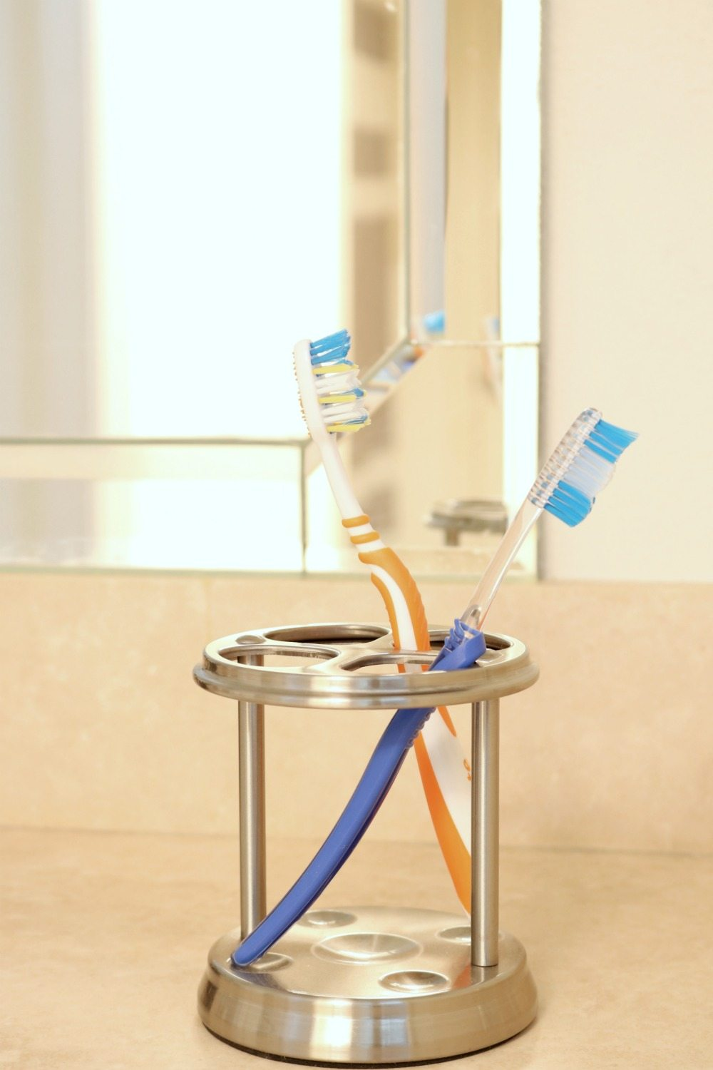 Have a place for the guest to put their toothbrush but keep it simple and easy to clean