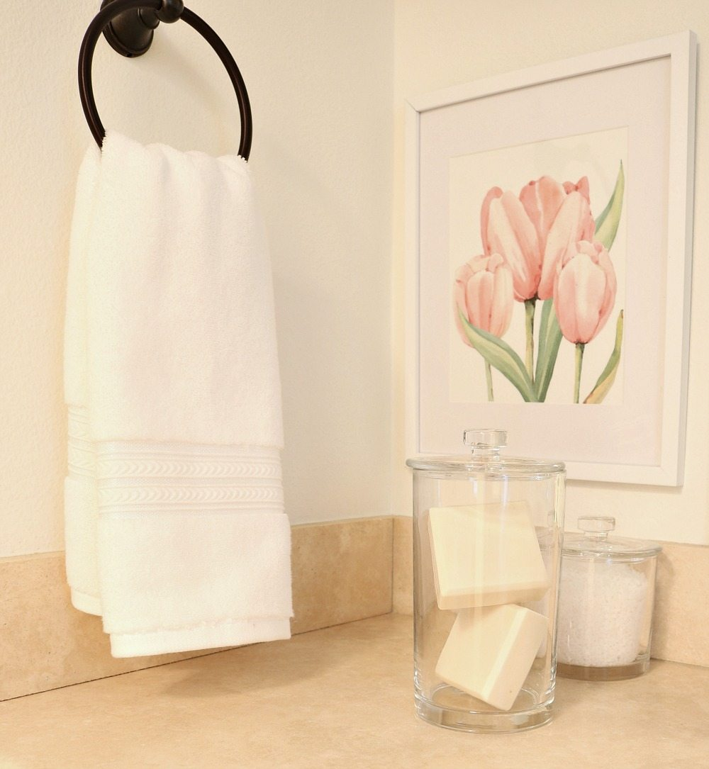 Love using white towels and simple clean storage for a clutter free bathroom