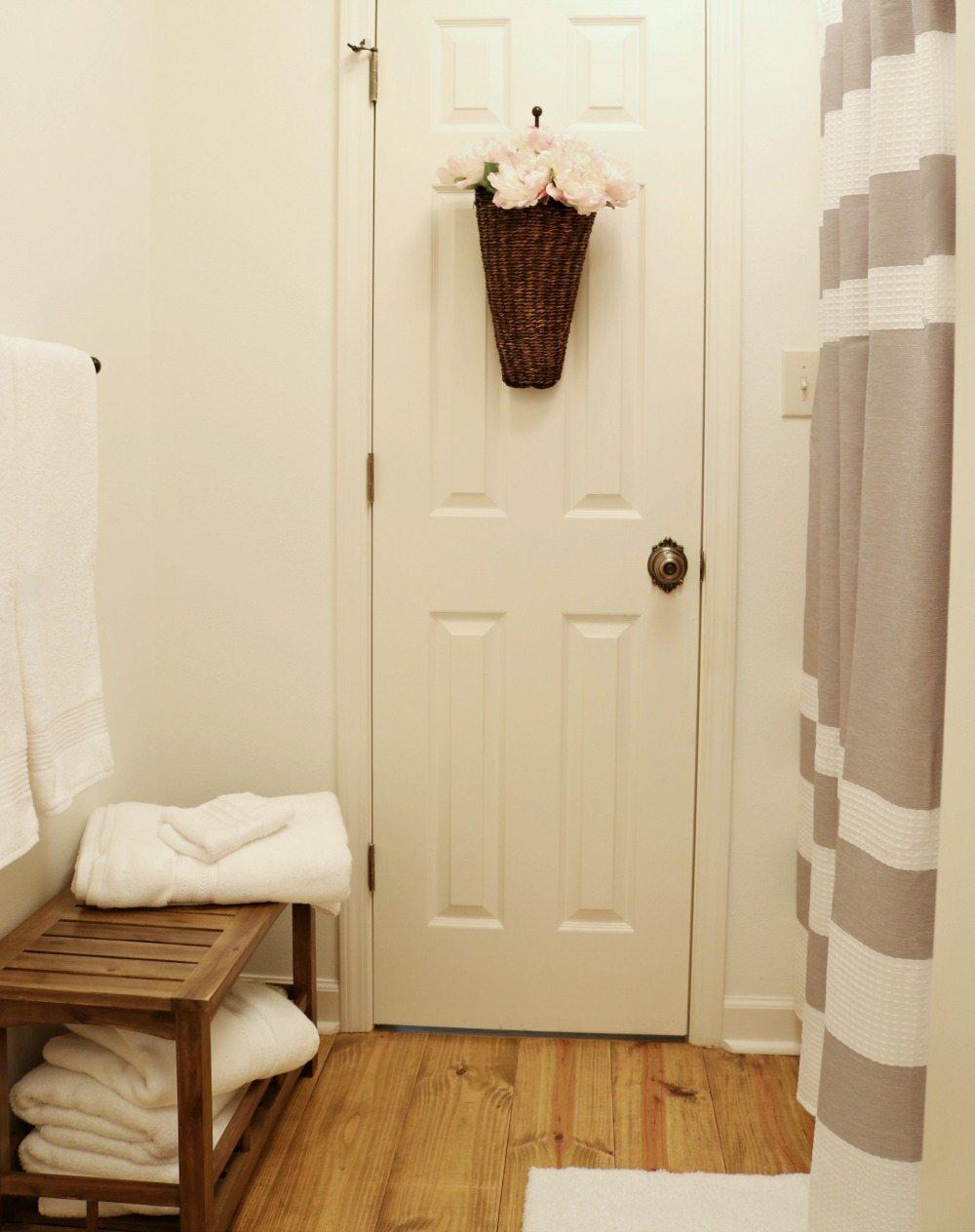 Pine floors in a simple farmhouse bathroom