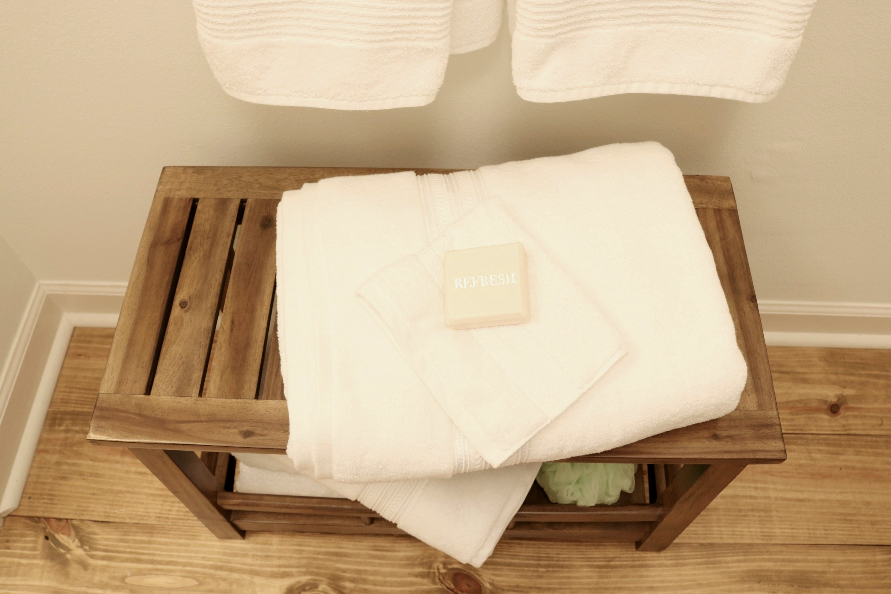 Plenty of white towel and sweet smelling soap for the minimal farmhouse bath