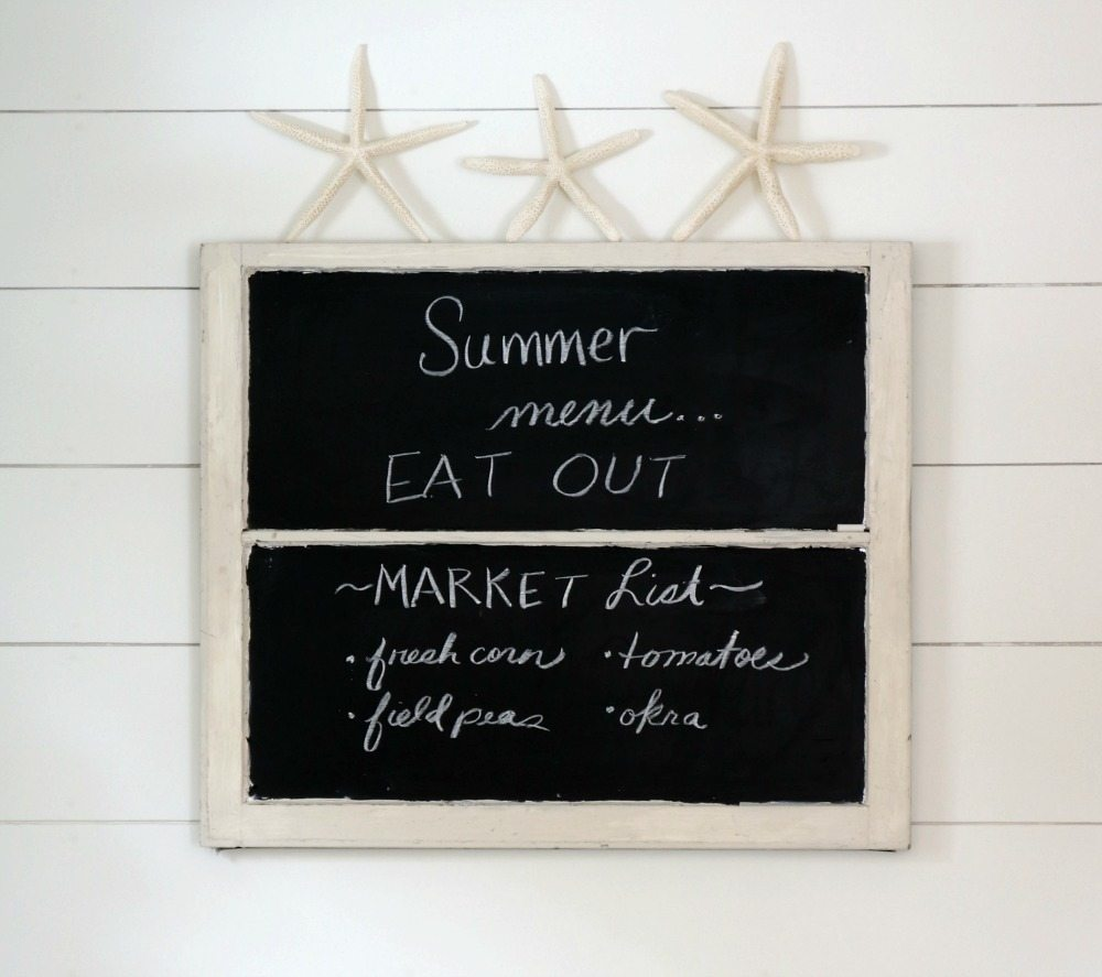 Starfish propped on an old window chalkboard perfect for summer in the farmhouse kitchen