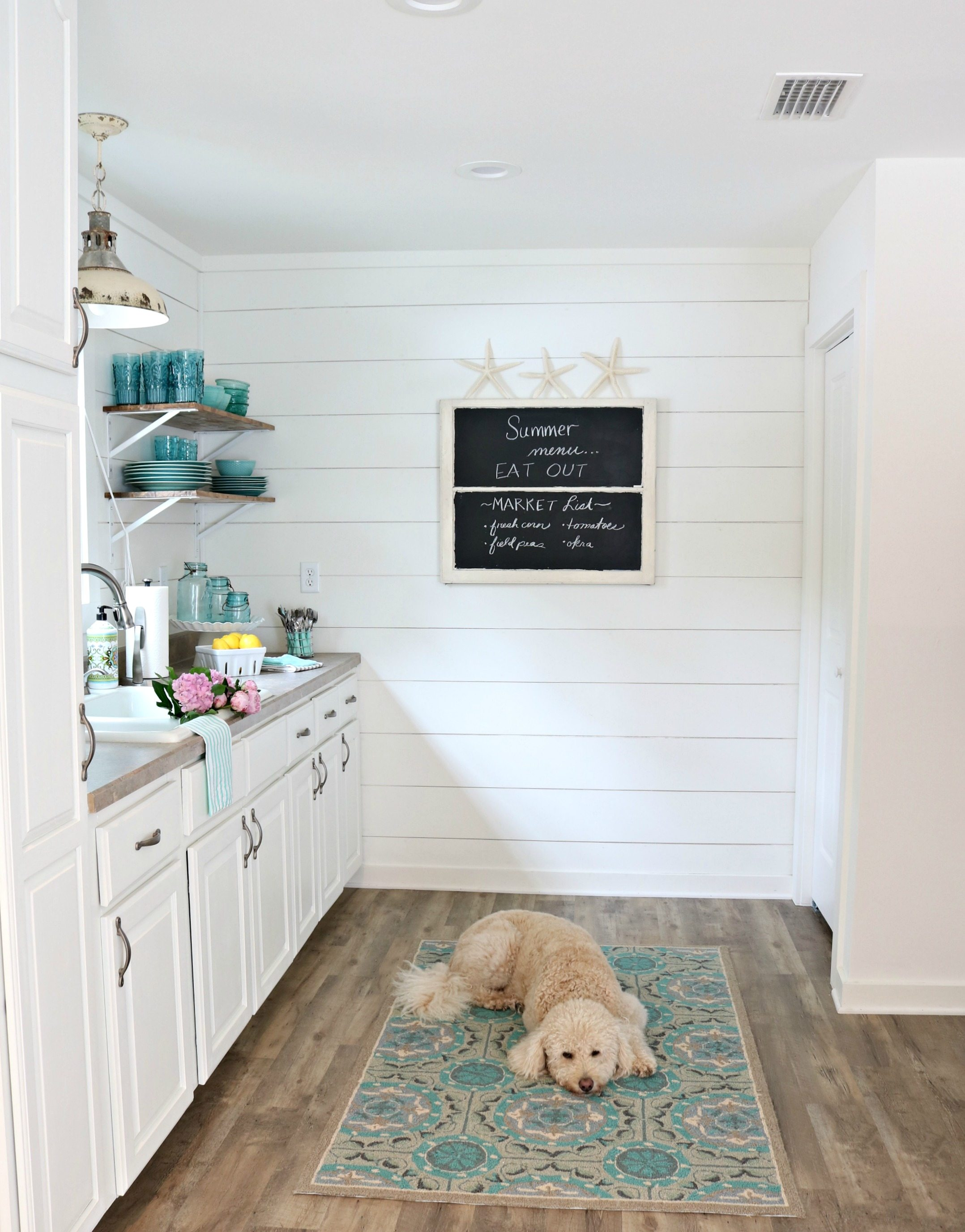 Tiny kitchen in the farmhouse cottage add interest with a shiplap wall or two at Refresh Restyle