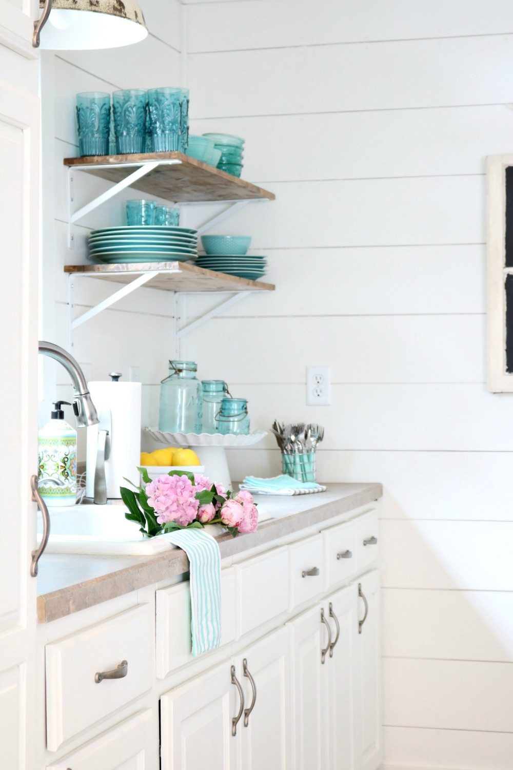 White shiplap and open shelves perfect for the farmhouse cottage look