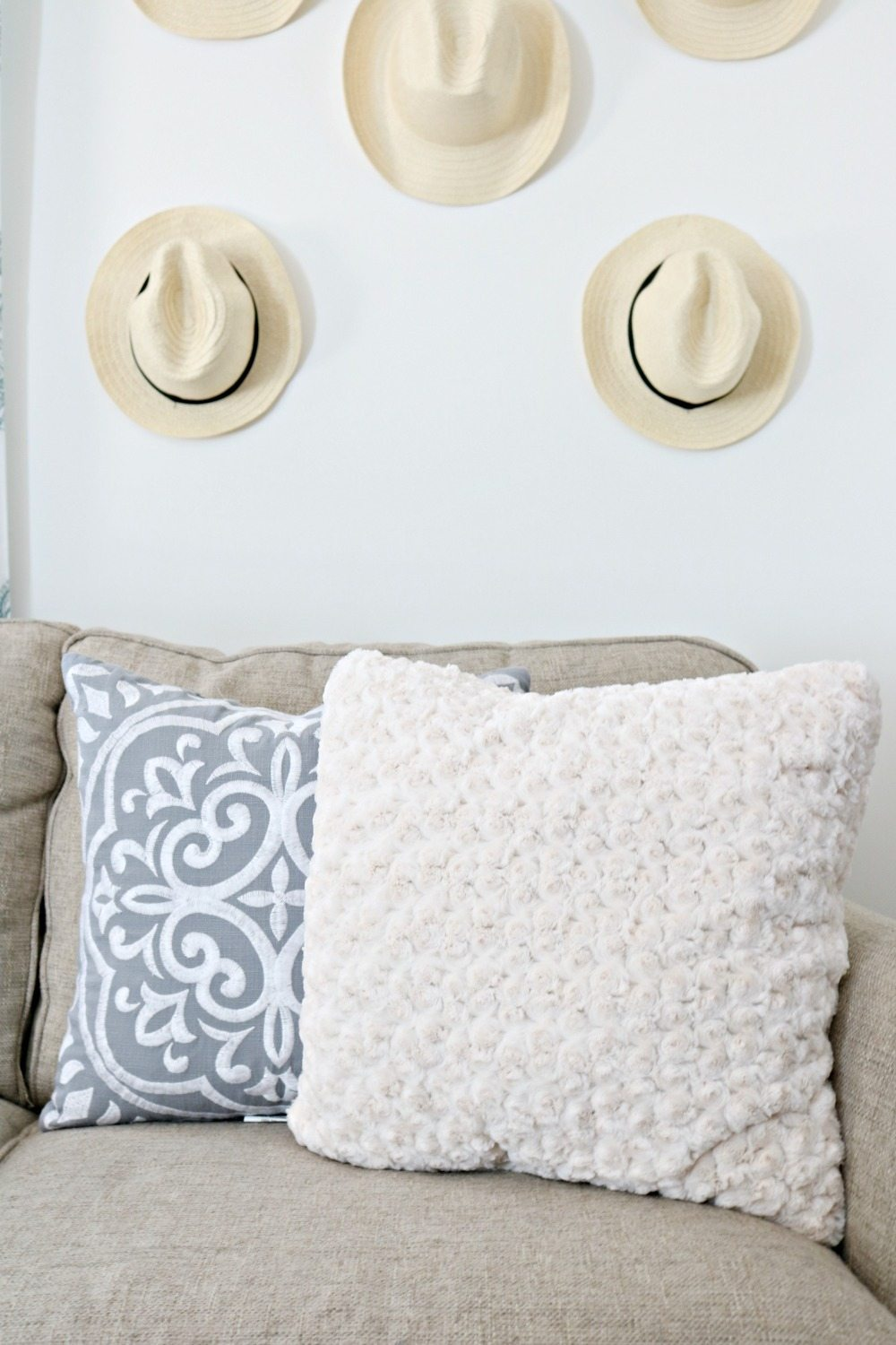 Mix of pillows add texture and color to any space