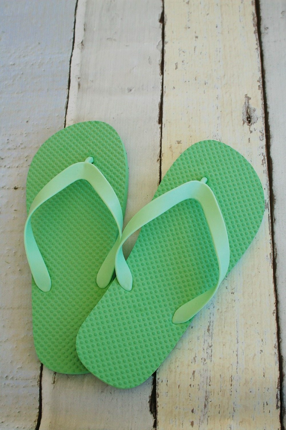 Plain flip flops can be transformed with iron on vinyl