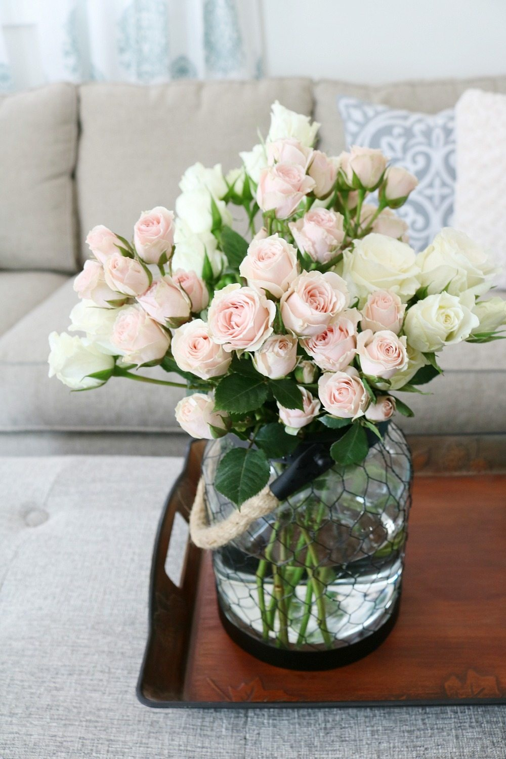 Roses in a rope handles chicken wire candle holder