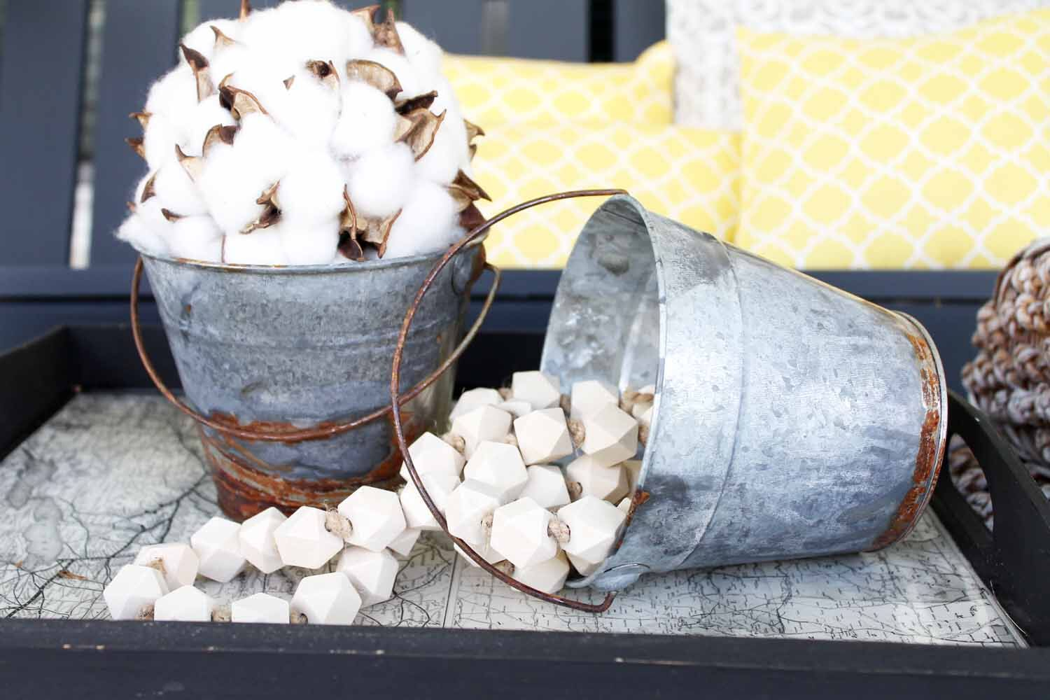 Metal buckets looks so rustic and perfect for the farmhouse look