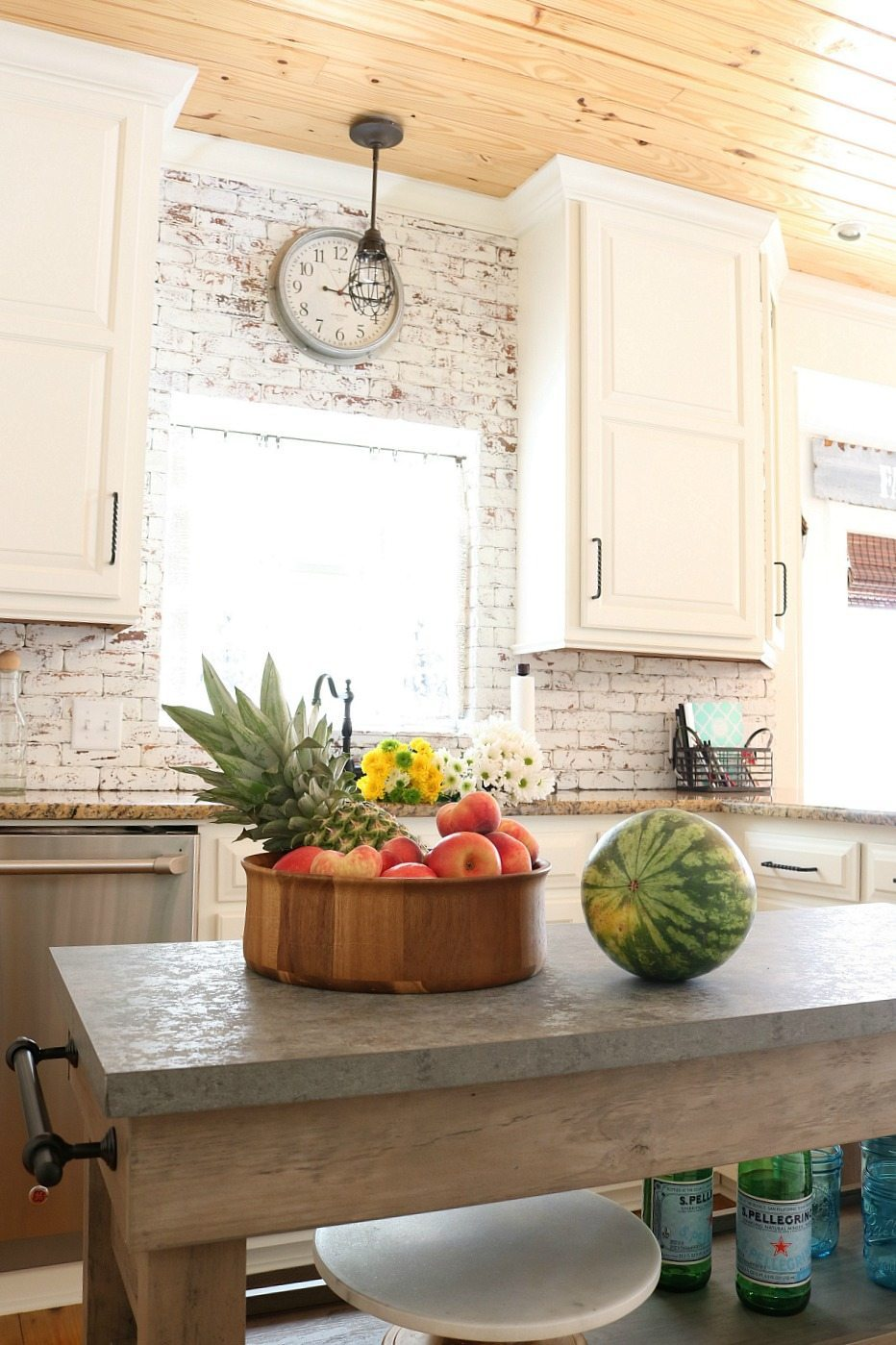Painted-brick-shiplap-ceiling-and-white-cabinets-farmhouse-looking-kitchen