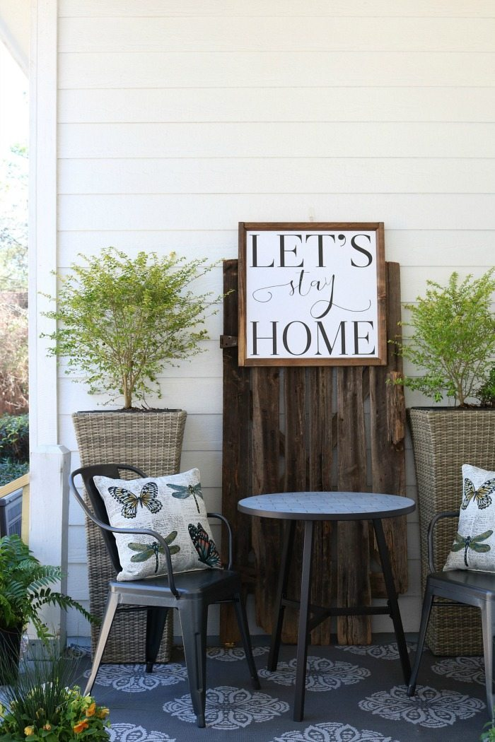 Shiplap-barn-wood-metal-chairs-make-a-great-conversation-area-on-the-porch-at-the-Alabama-Farmhouse-1