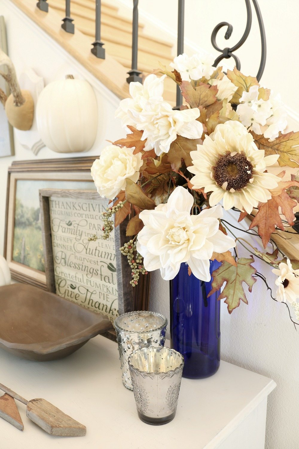 Cream flowers in a blue vase for fall