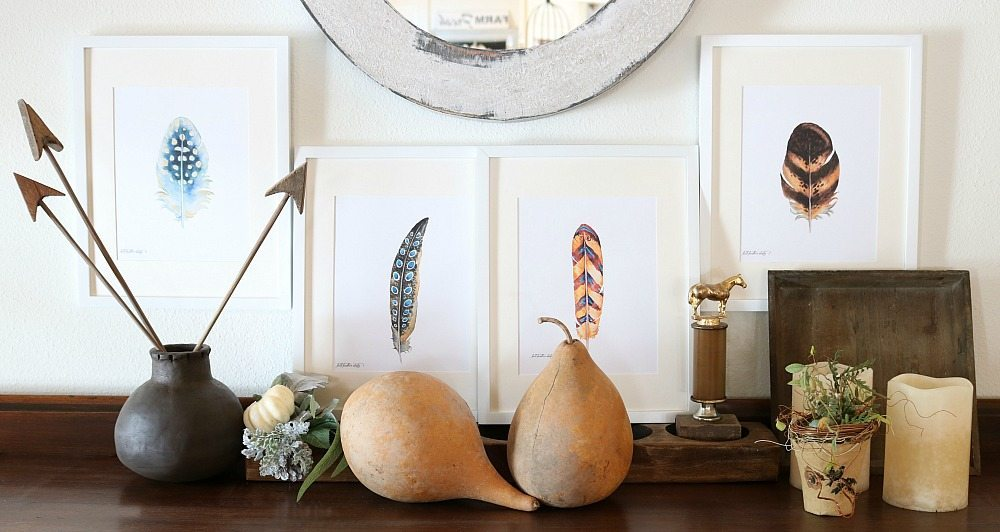 Feather prints in white frames for fall
