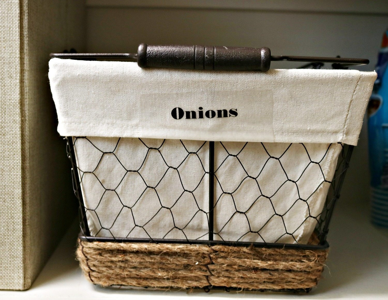 Separate baskets for potatoes and onions in the pantry