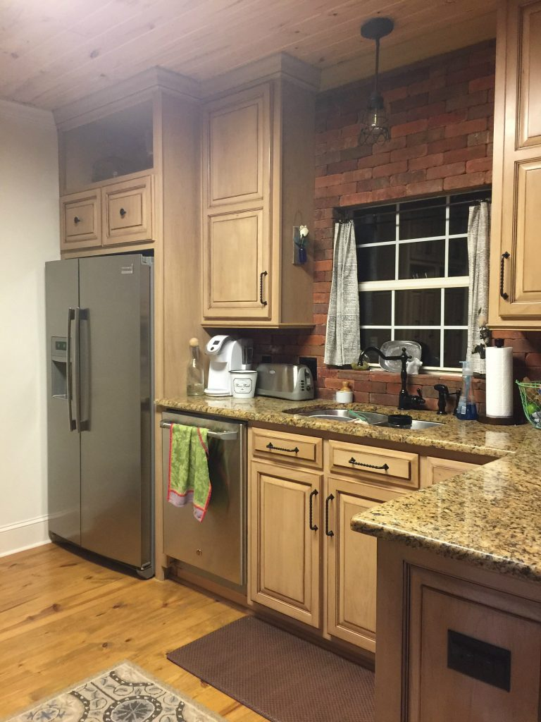 Before brick backsplash and cabinets painted