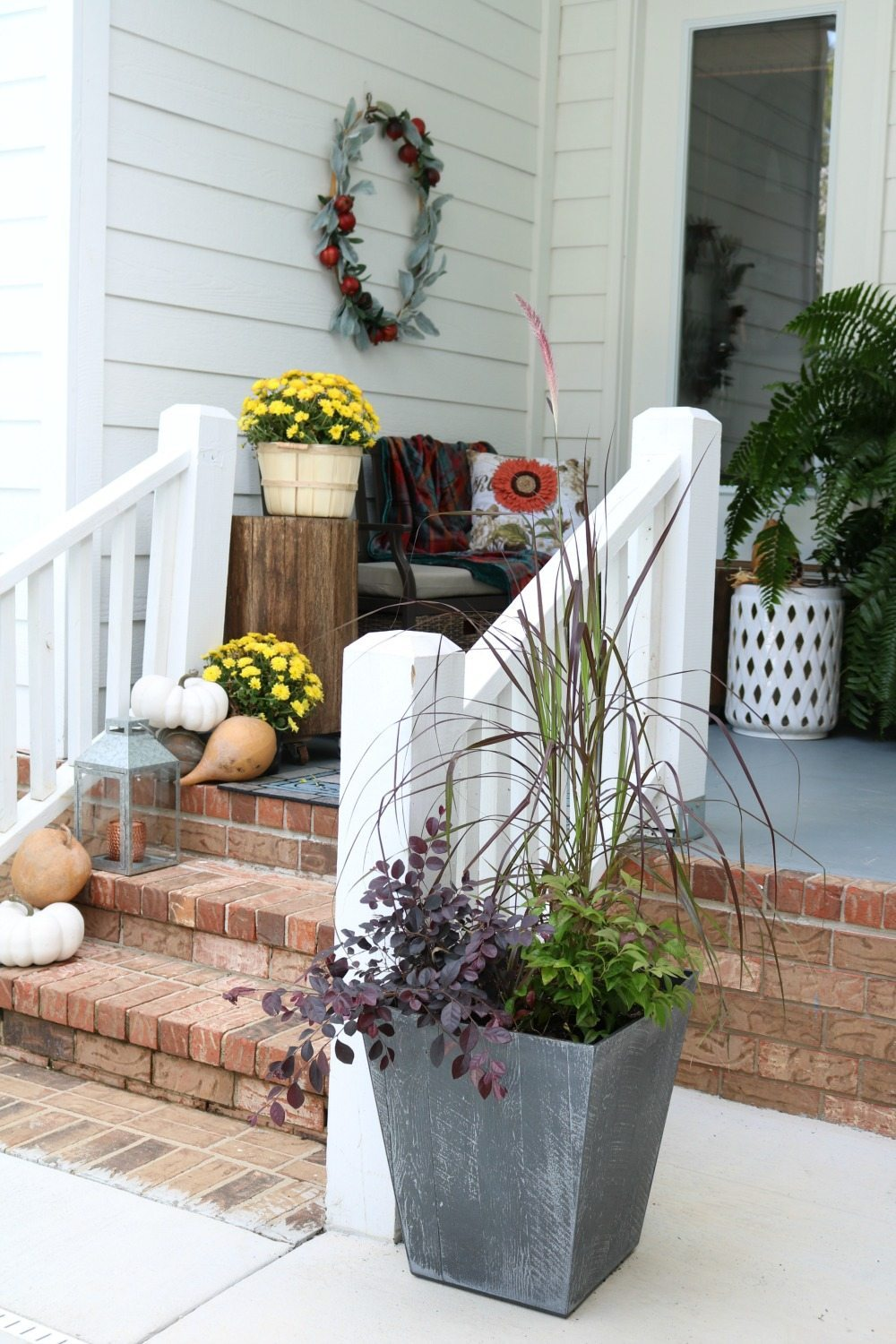 Fall filled planters mums and more
