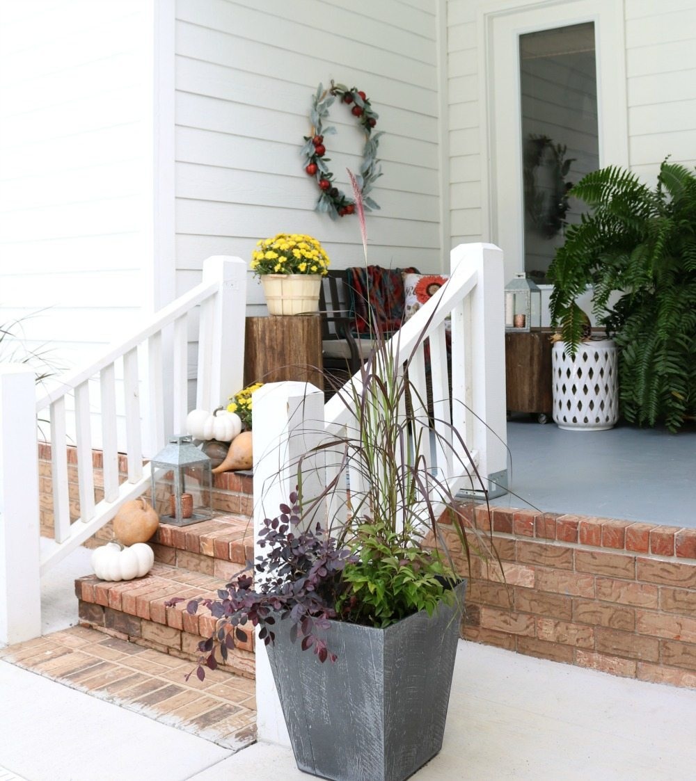 Planters with fall foliage for the side entry