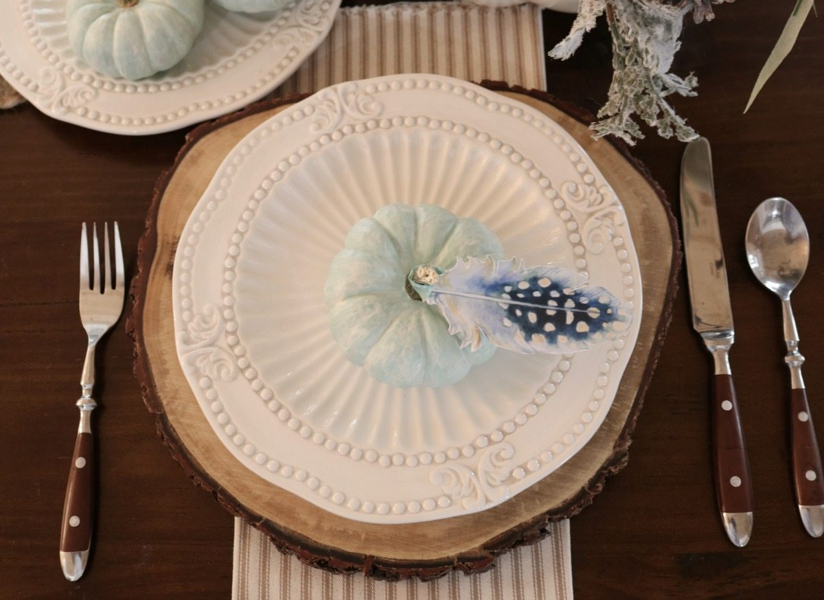 Soft blue pumpkins and paper feathers