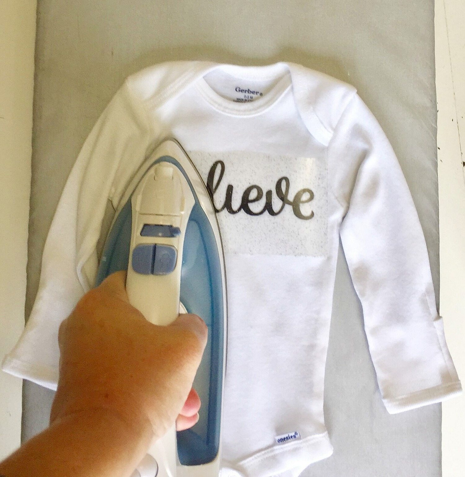 Apply heat and pressure for baby onesie
