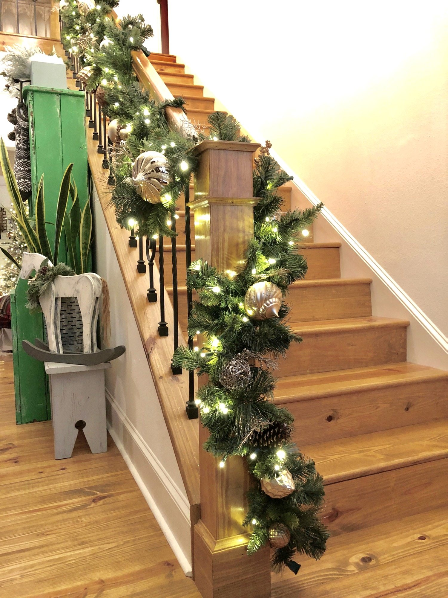 Christmas entry with lighted garland